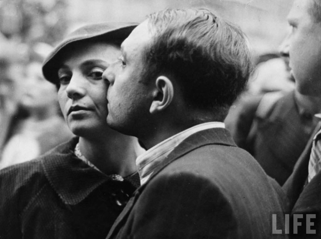 Man kissing woman goodbye as he leaves during mobilization of French reservists. Location: Paris, France Date taken: September 1938 Photographer: Kitrosser