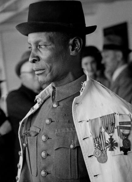 African chief Samba Taraore of French Sudan attending Bastille Day celebrations. Location:Paris, France Date taken:1939 Photographer:Kitrosser