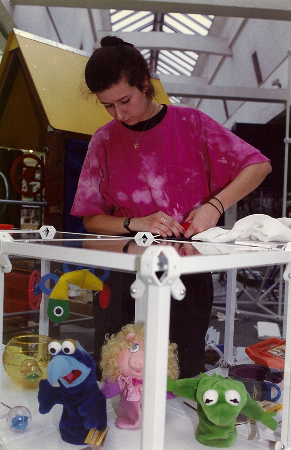 1989- Guide Andrea Rutherford assembles the childrens' toy section at Design USA. [Photo by Amanda Merullo, 1989]