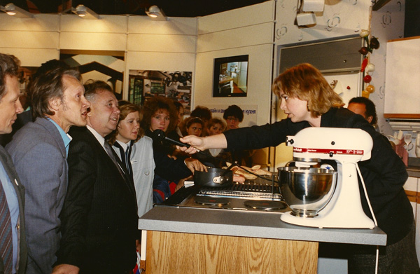 1989- Guide Anna Obolensky interviews audience members at the popular kitchen stand at Design USA. [Photo by Amanda Merullo,1989]