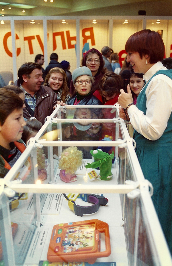 Moscow, 1989- Guide Valerye Strochak shows young Russians toys from America at Design USA. [Photo by Amanda Merullo, 1989]