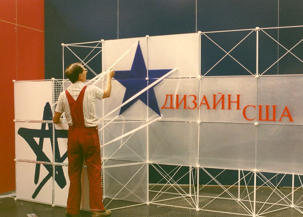 Moscow, 1989- Worker from Italian Carli firm constructs the exhibit's opening panel at Design USA. [Photo by Amanda Merullo, 1989]