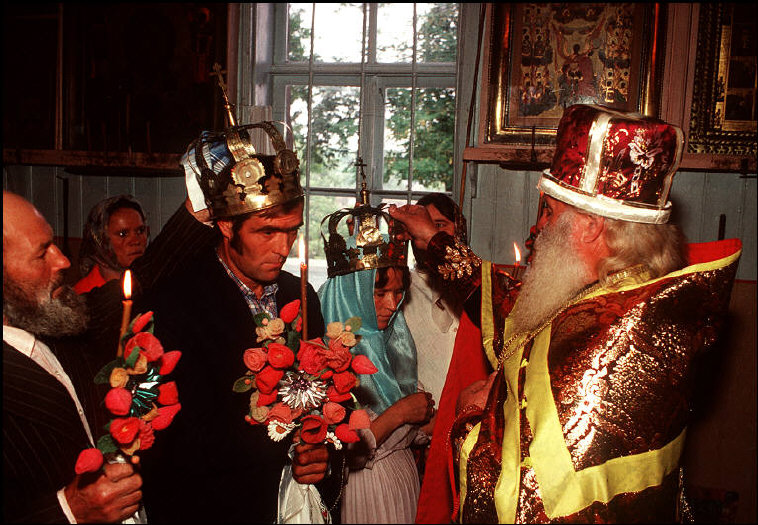 "MOLDAVIA. Kounicha village. Father ANDRENNITOV blesses a triple wedding among the ""Old Believers"". 1988."
