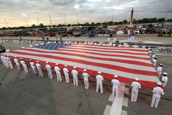 Happy-Birthday-USA-flag-unfurling-during-pre-race-ceremonies-Milwaukee-Mile-racetrack