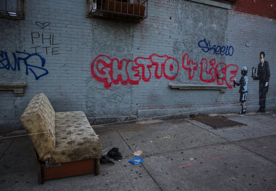 another-one-from-banksys-attack-on-new-york-city-this-time-in-the-bronx-pokes-fun-at-graffiti-and-its-begrudging-acceptance-by-the-upper-class-art-world