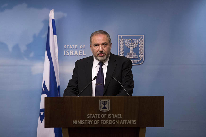 epa04511792 Israeli Foreign Minister Avigdor Lieberman speaks as he address the upcoming early elections during a press conference at the Israeli Foreign Ministry in Jerusalem, Israel, 02 December 2014. Israel appears headed toward an early election after Prime Minister Benjamin Netanyahu and a key coalition partner failed to bridge differences on the budget and a Jewish nation state proposal, The Jerusalem Post reported. EPA/ABIR SULTAN